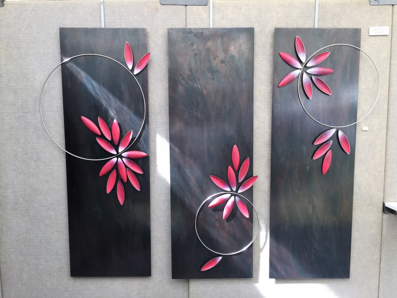 Stainless steel panel Triptych Red Pods and Rings